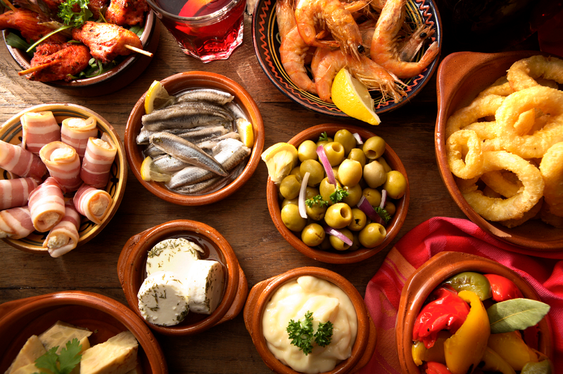 Greek specialities, presented in marble bowls on a wooden table.